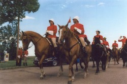 Individuals and horses in full NWMP Great March re-enactment regalia photographed near Mossbank in 1999.
